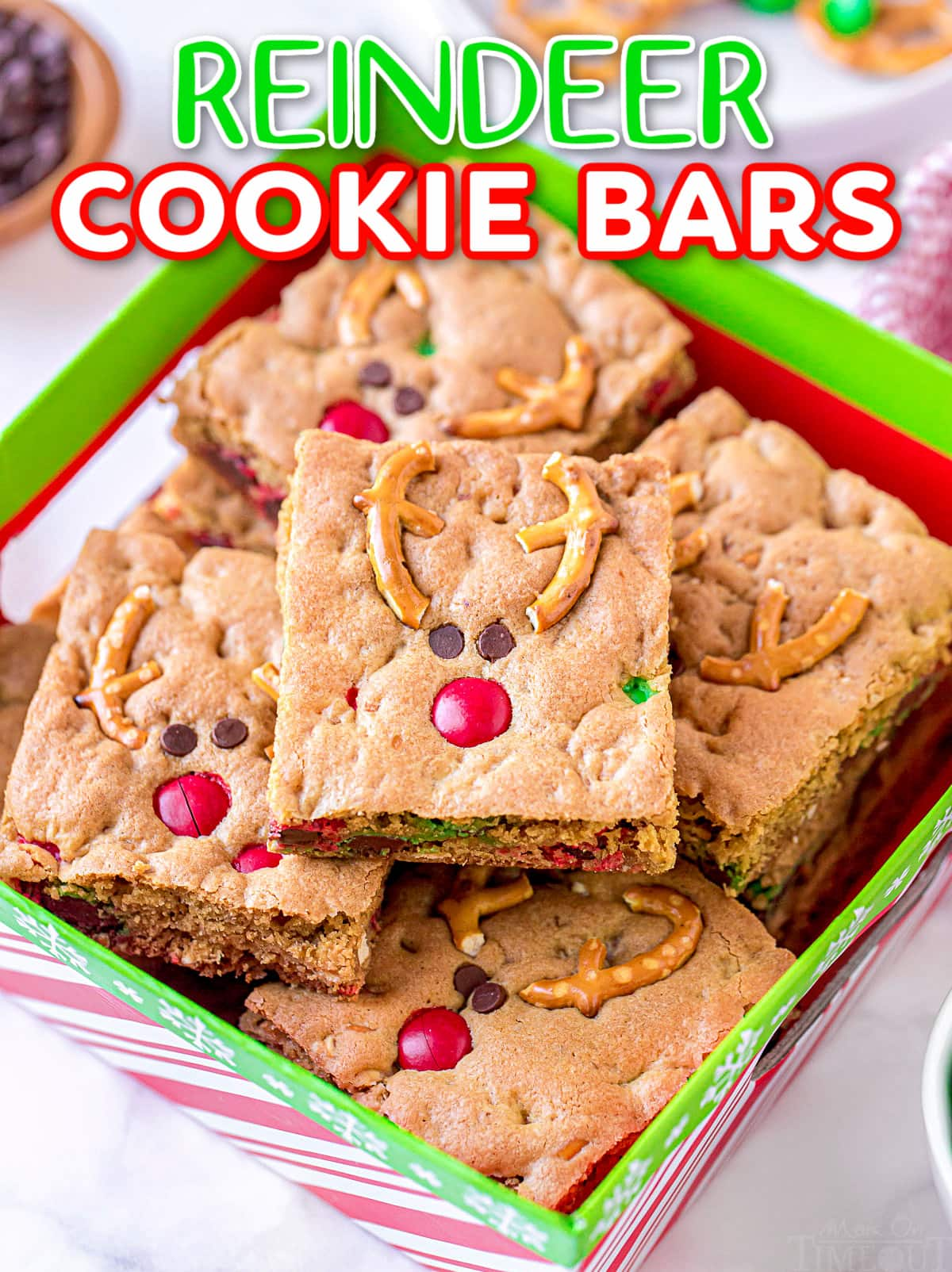 cookie bars stacked in red and green christmas box with title overlay at the top of the image