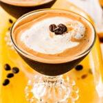 espresso martini recipe in two glasses on yellow glass tray top down view square