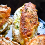 pan seared chicken in cast iron skillet stuffed with goat cheese