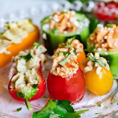 plate of hummus stuffed veggies drizzled with olive oil