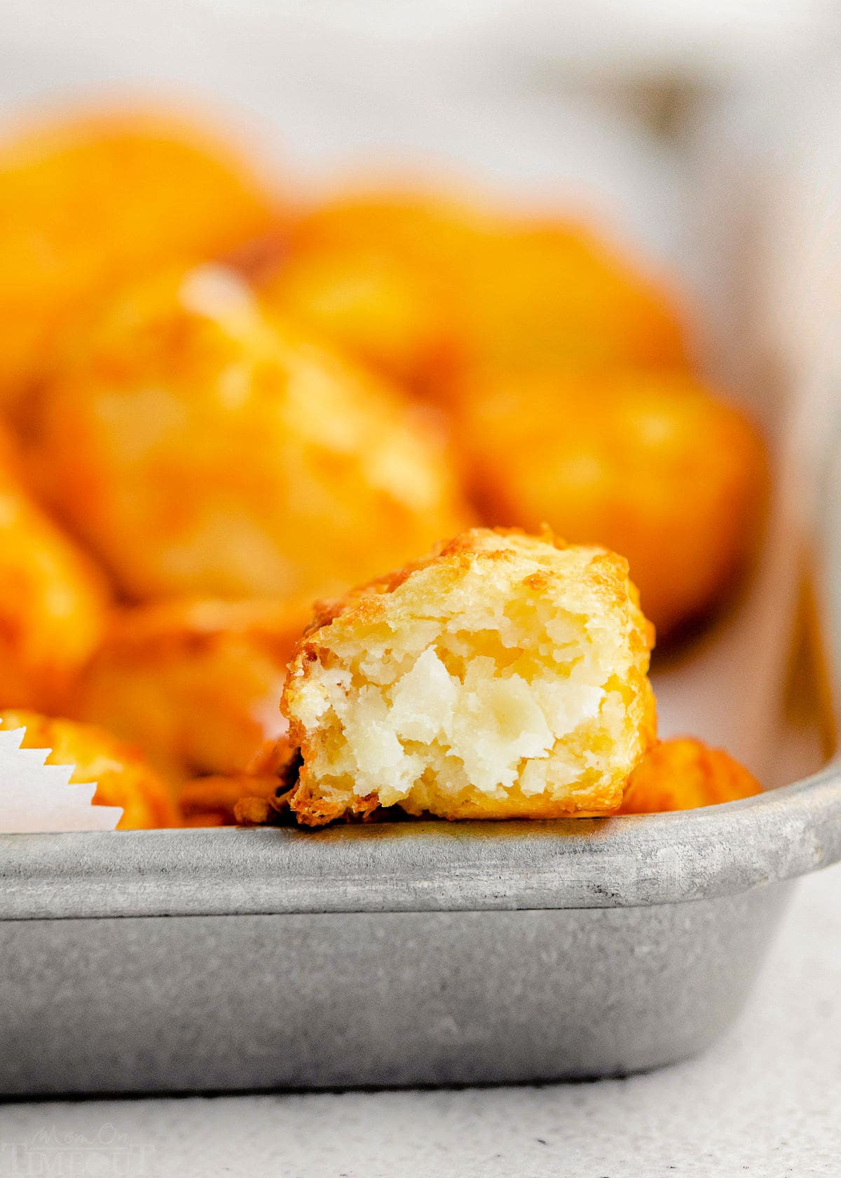 half of tater tot showing fluffy insides.