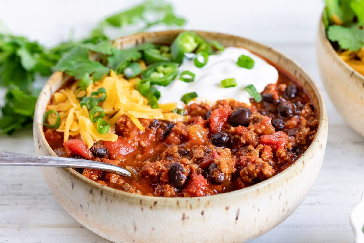 spoonful of turkey chili in bowl.
