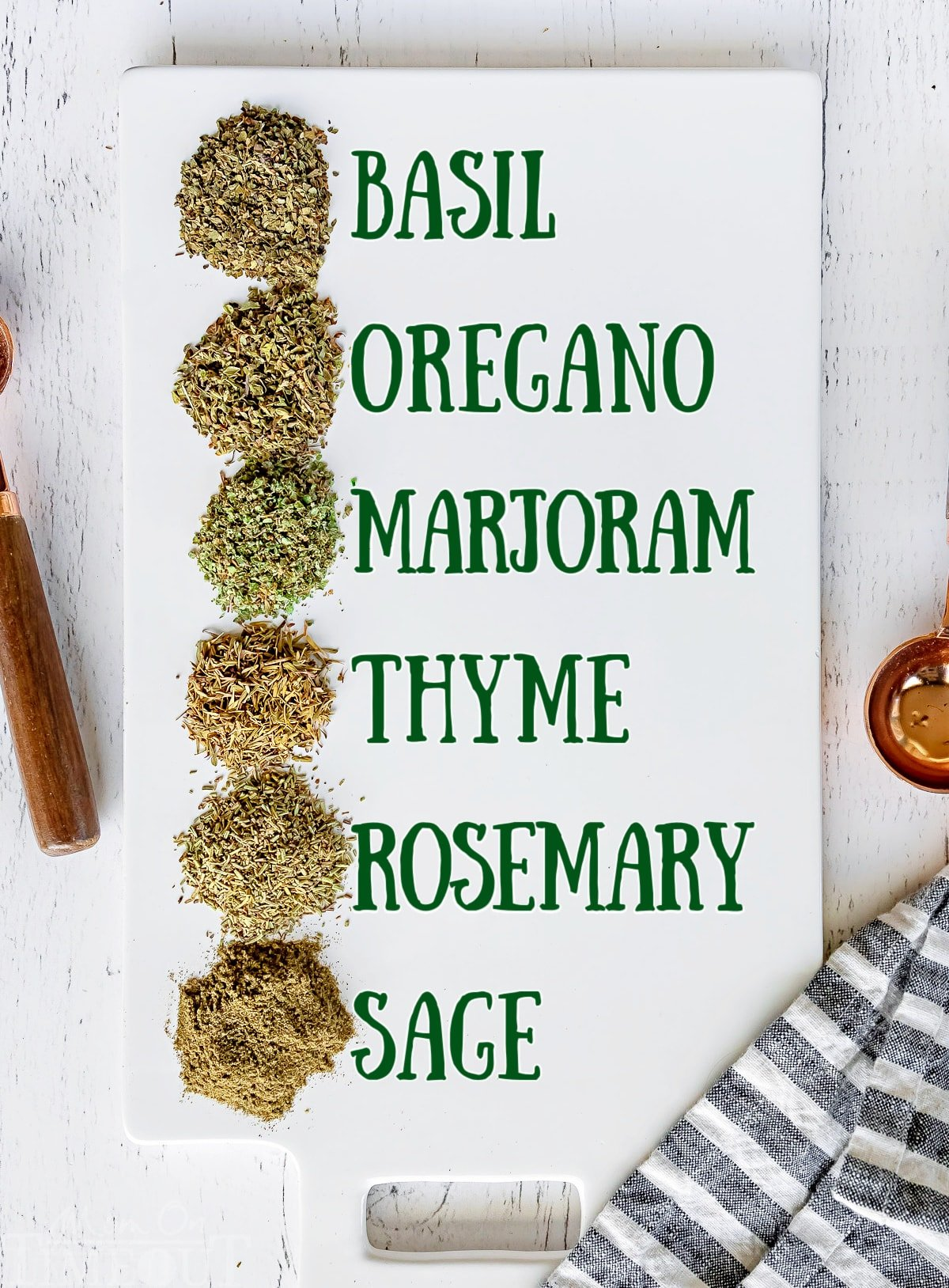 italian seasoning ingredients measured out on white cutting board with labels to the side.