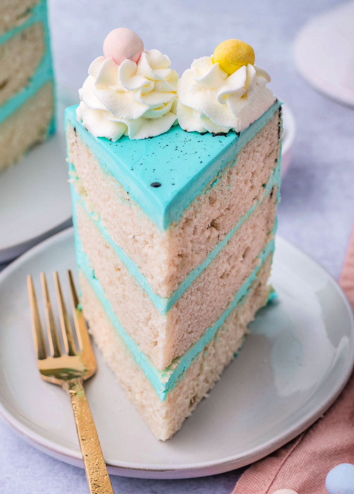 one slice of vanilla cake decorated with blue frosting and cadbury eggs.