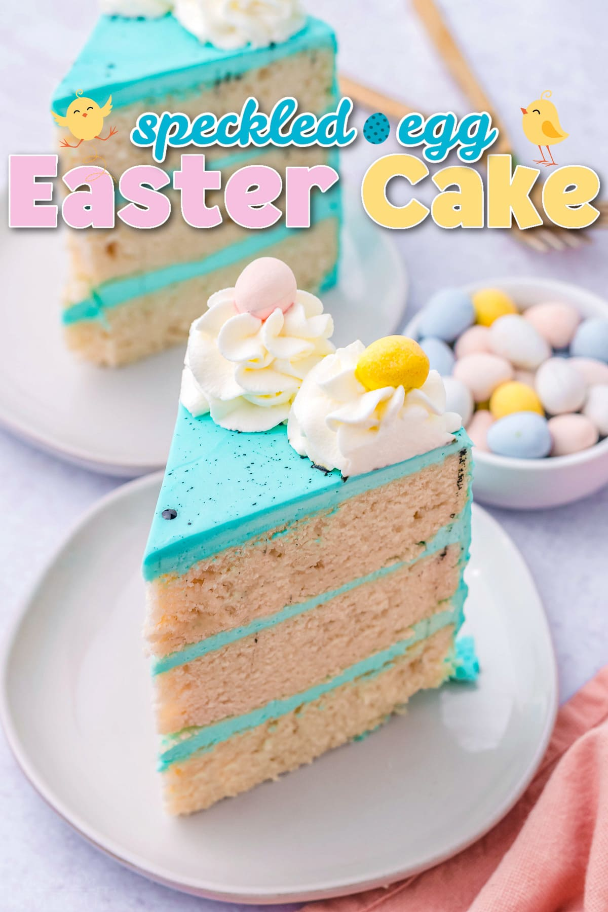 two slices of easter cake with bright blue frosting decorated with cadbury eggs. title overlay at top of image.