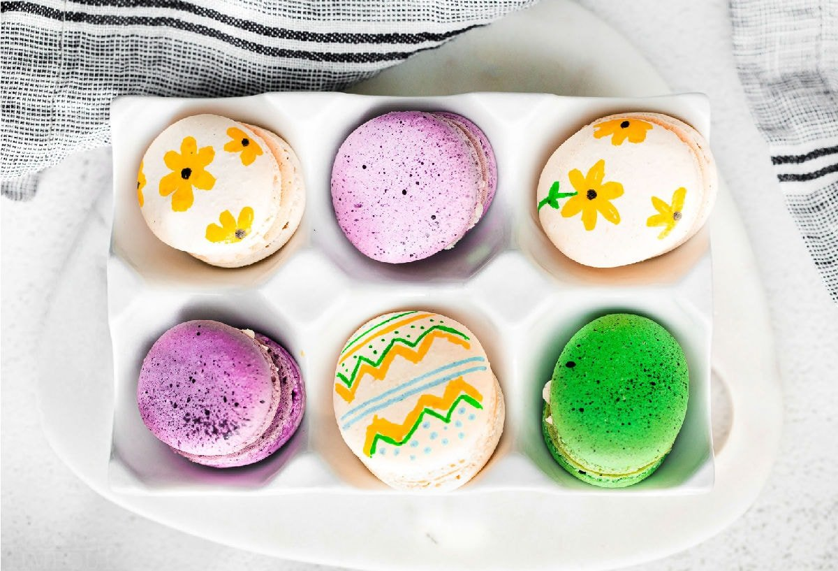 top down look at 6 decorated easter egg macarons.