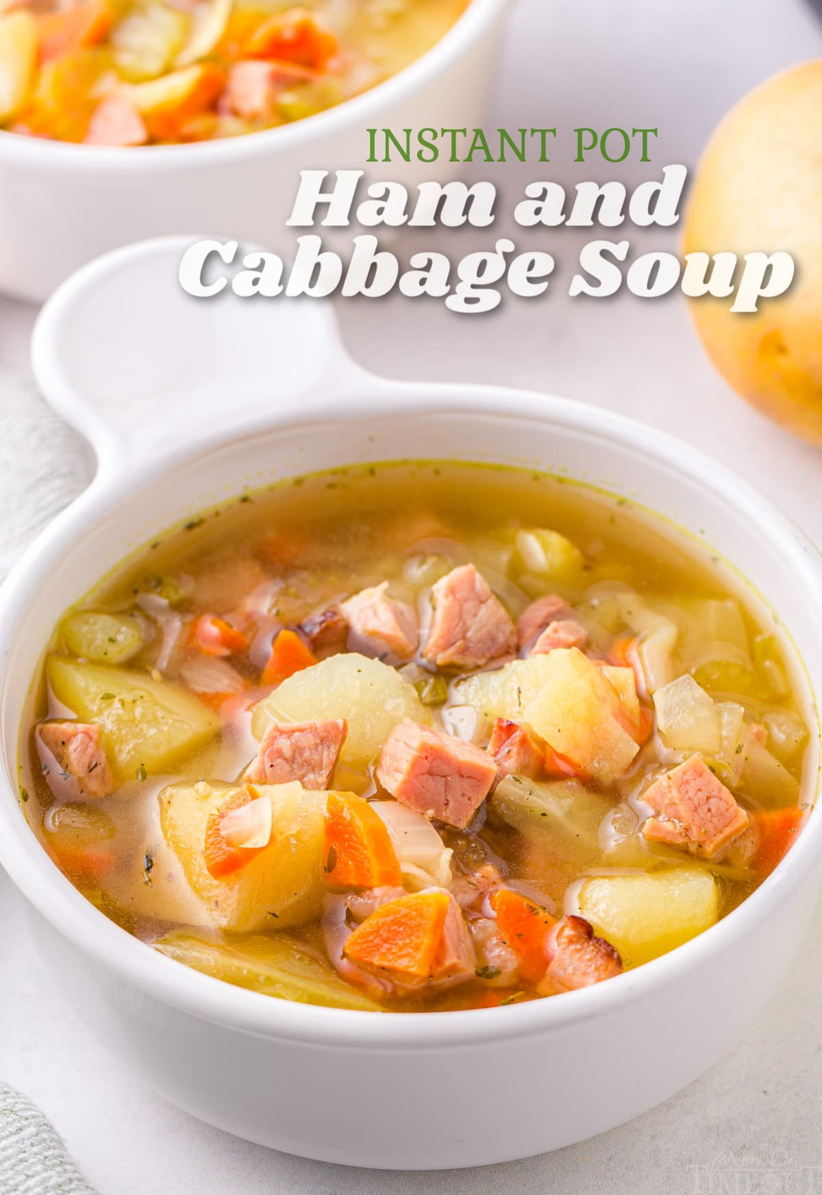 white bowl of cabbage soup with ham and title overlay at top of image.