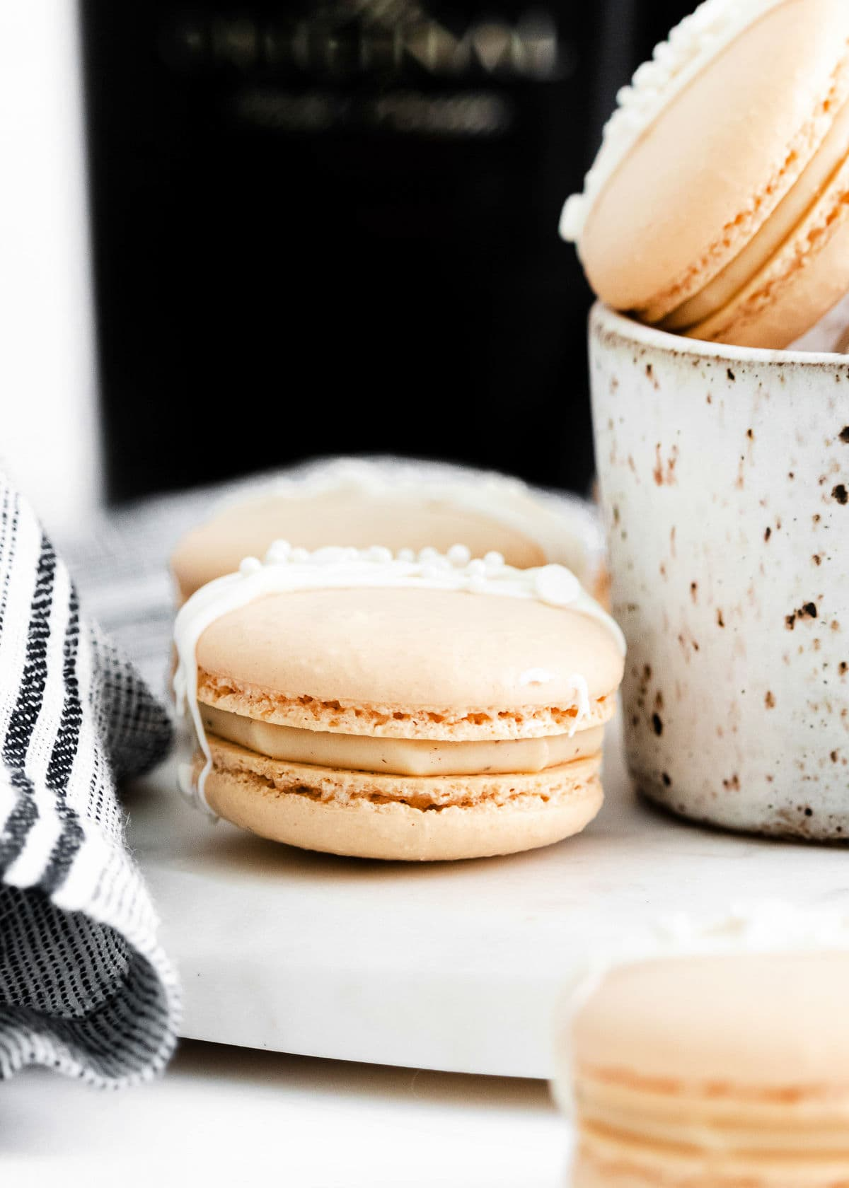close up look at Irish cream macarons with drizzle on top.