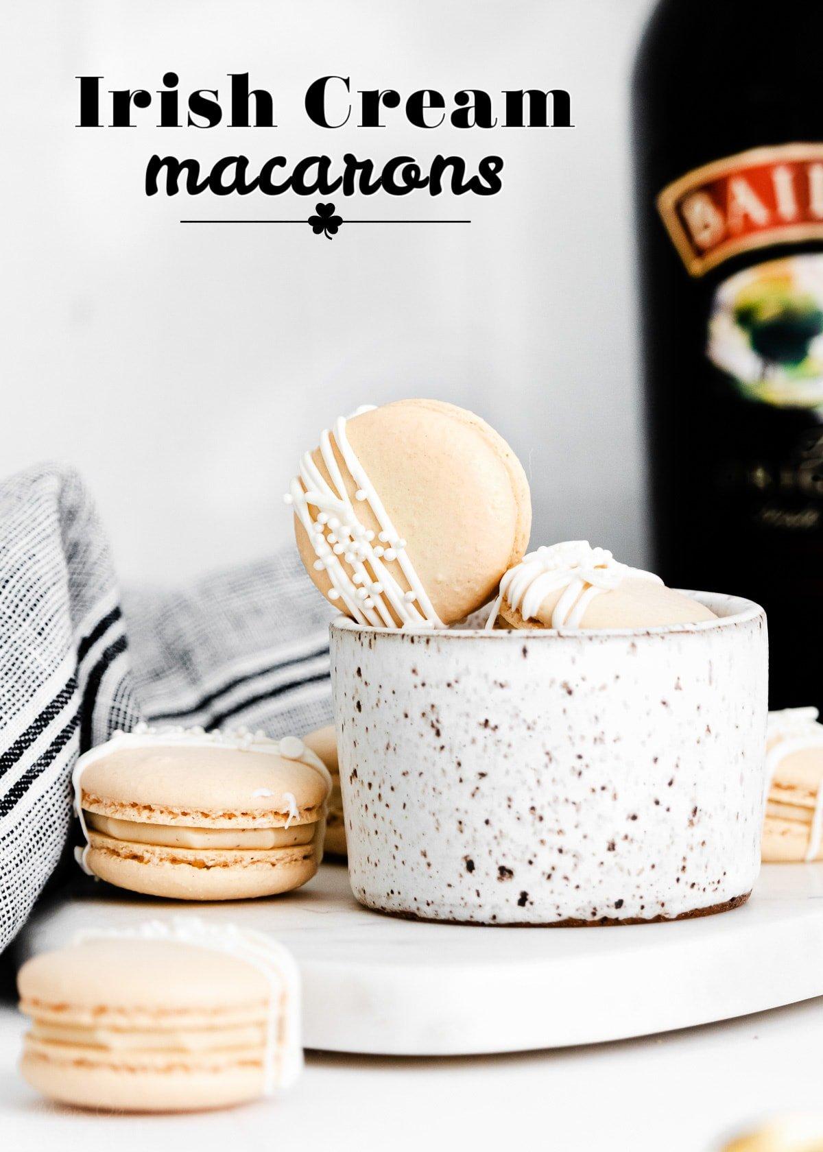 irish cream macarons next to bottle of baileys with title overlay.