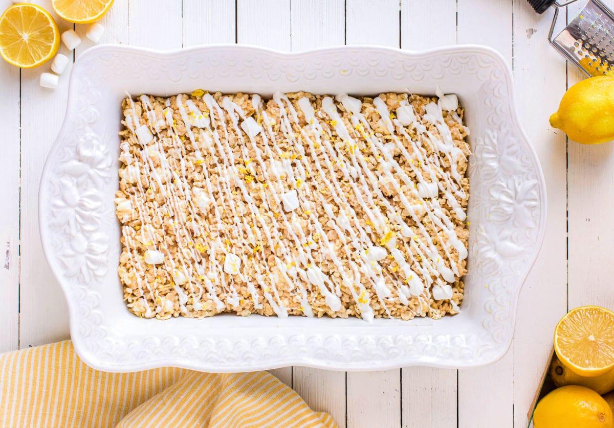 lemon rice krispie treats in white baking dish.
