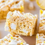 lemon rice krispie treat cut into a square with lemon zest and white drizzle on top.