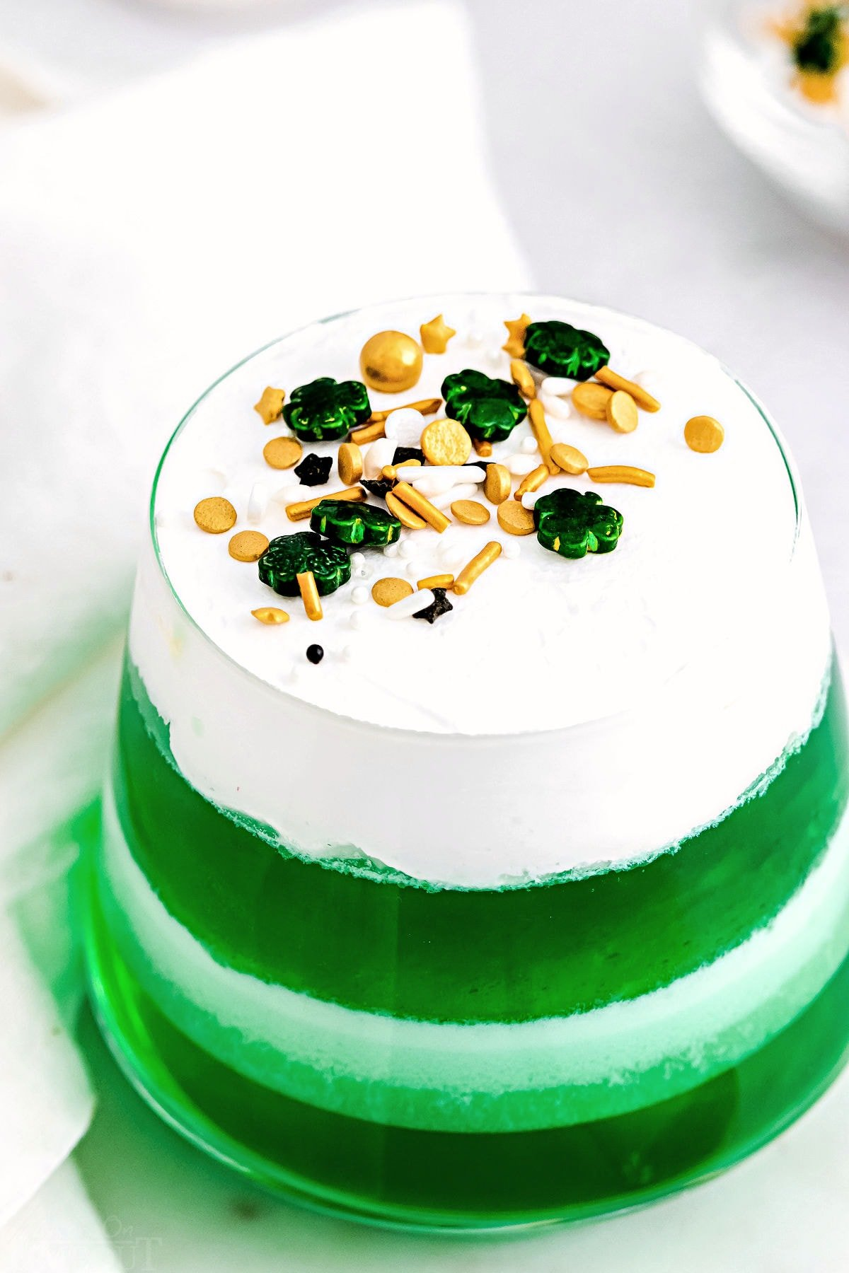 top down view of lime jello layered cups.