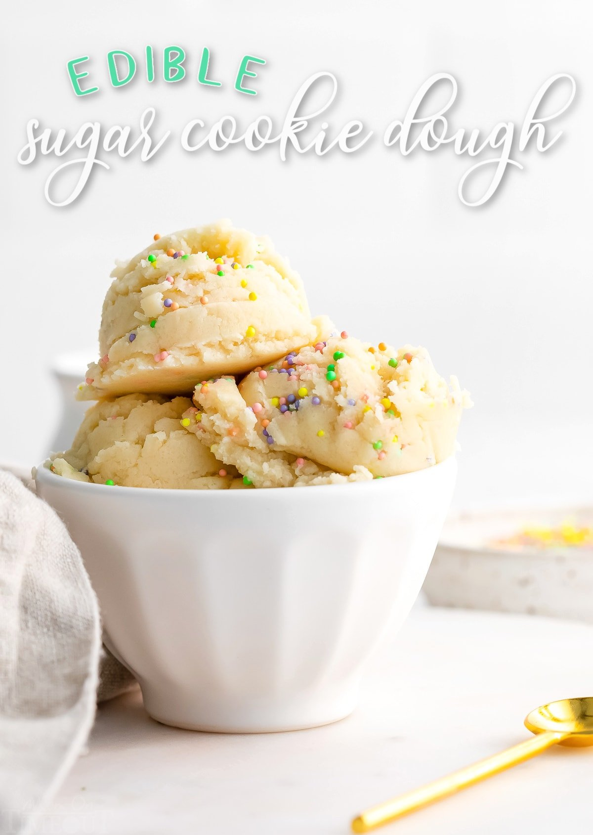 edible sugar cookie dough in small white bowl with sprinkles on top. title overlay at top of image.
