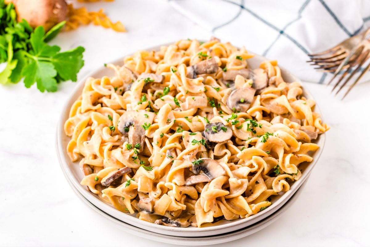 full plate of mushroom stroganoff garnished with parsley.