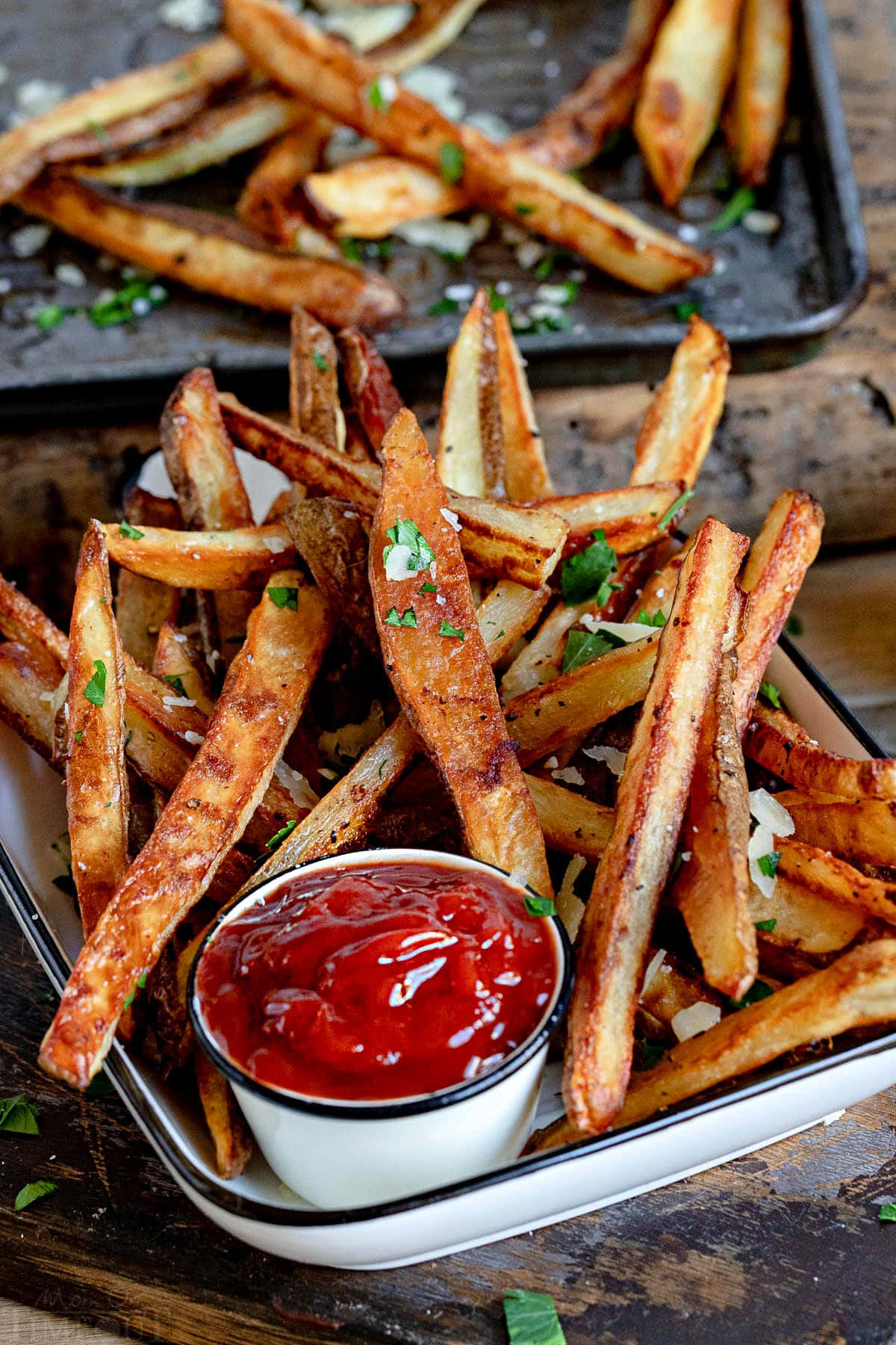 perfectly crisp oven fries piled high with Parmesan cheese and parsley. Served with ketchup on the side.