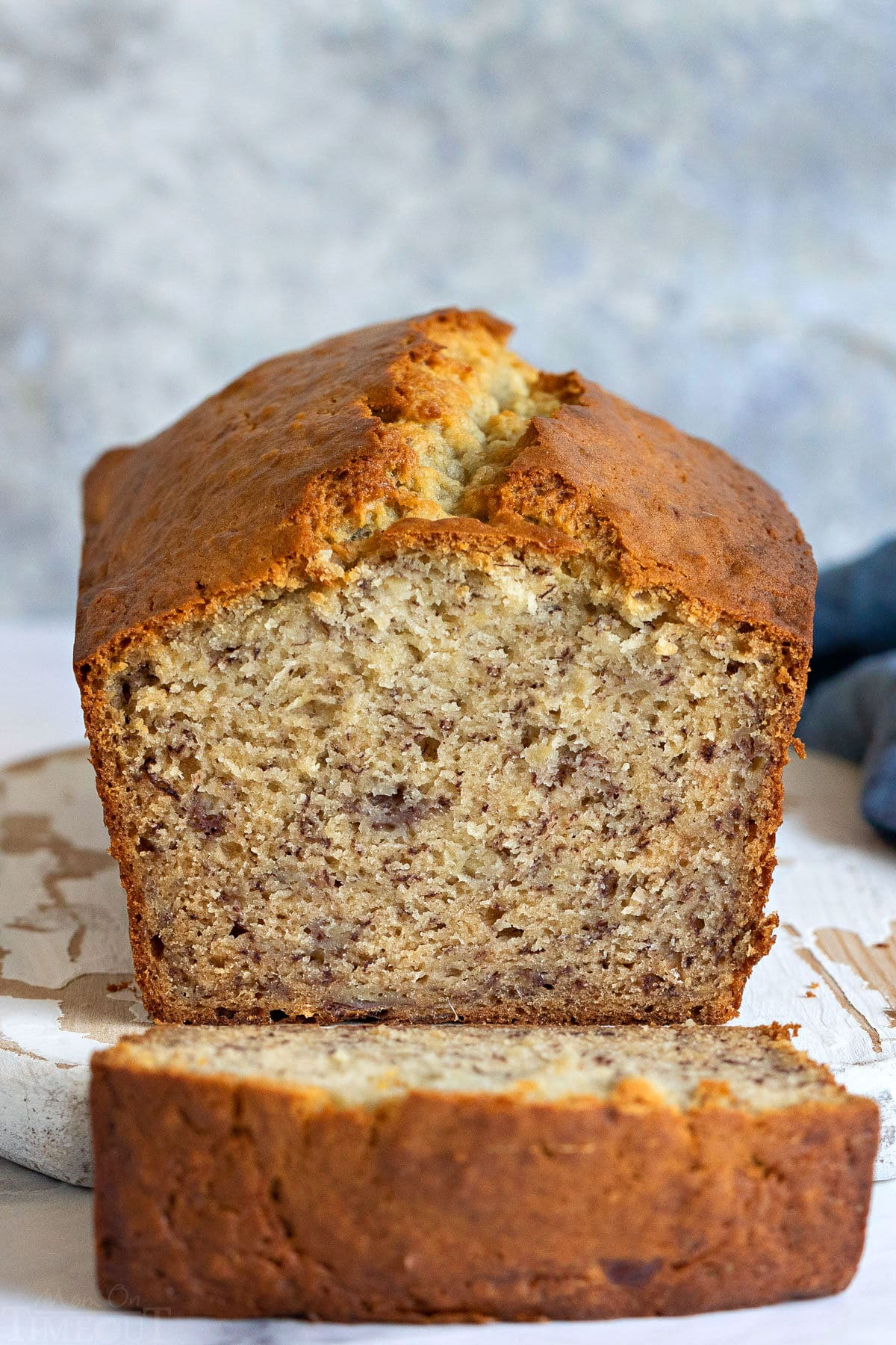 loaf of banana bread with one slice cut.