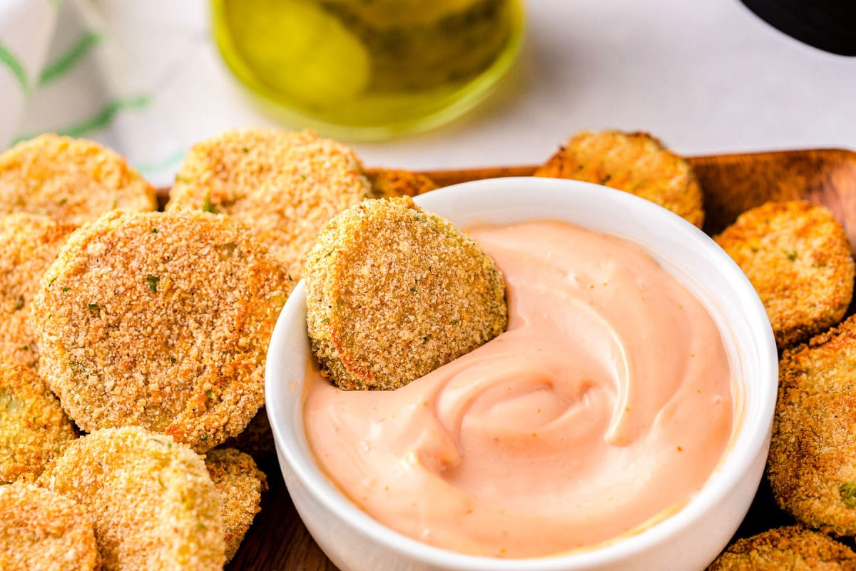 fried pickles being dipped in fry sauce