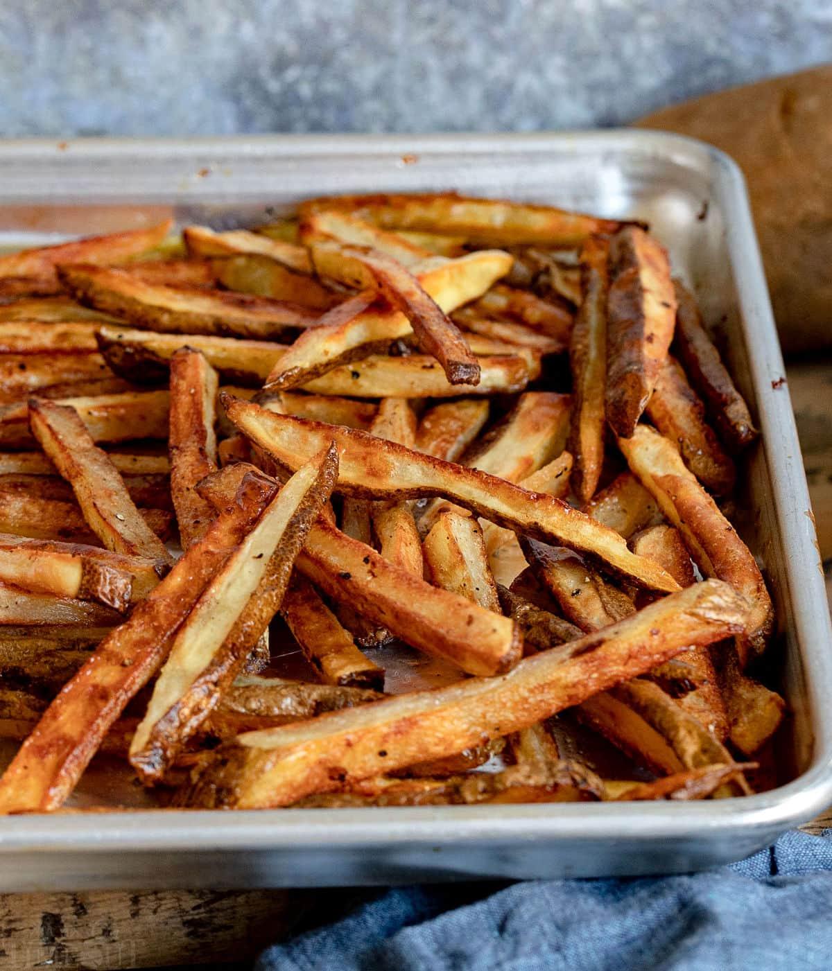 lots of crispy oven fries on baking sheet.
