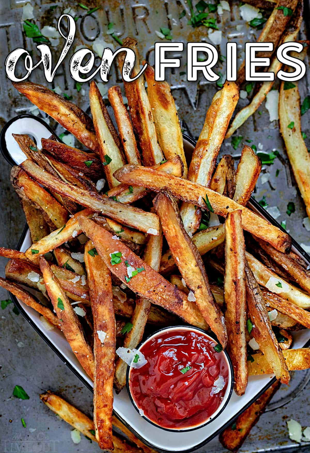 pile of oven fries on baking sheet with small bowl of ketchup. title overlay on top of image.