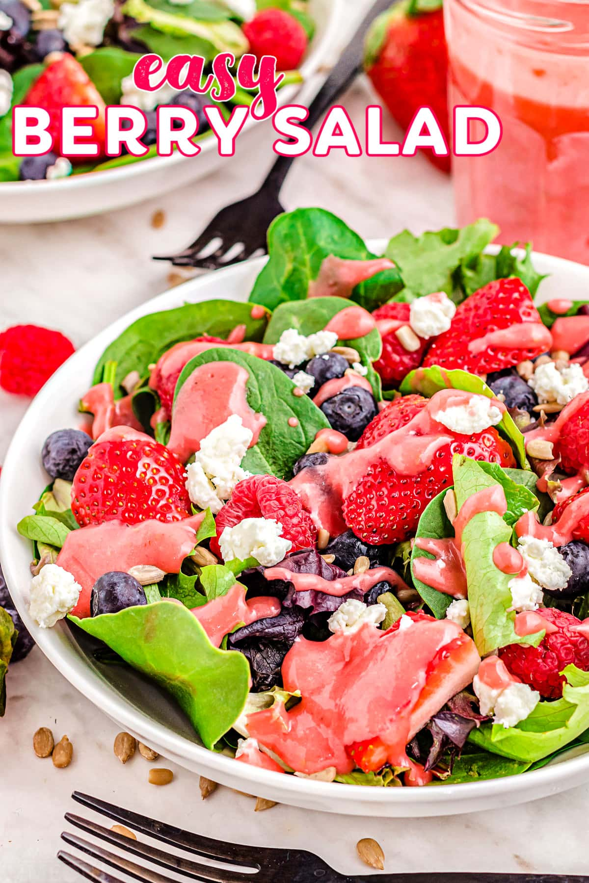 top down look at berry salad with raspberries, strawberries and blueberries. title overlay at top of image.