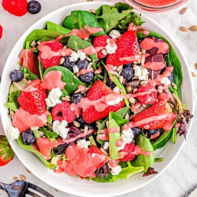 top down view of berry salad with raspberry vinaigrette ready to serve.