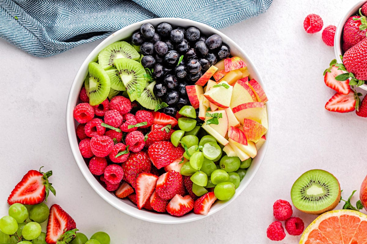 fruit salad ingredients in bowl ready to be tossed together.