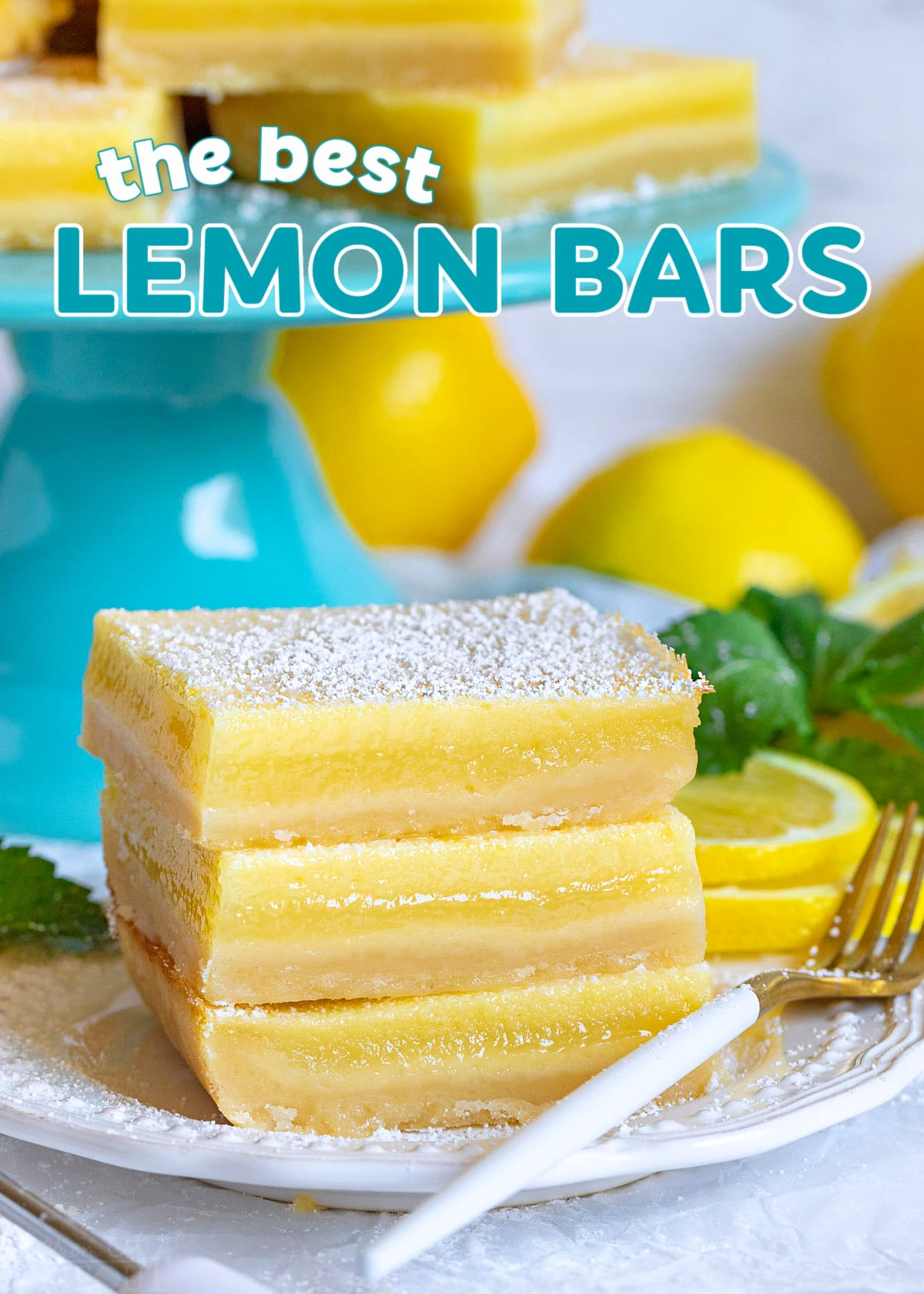 lemon bars stacked three high on white plate in front of teal cake stand with more lemon bars. title overlay at top of image.