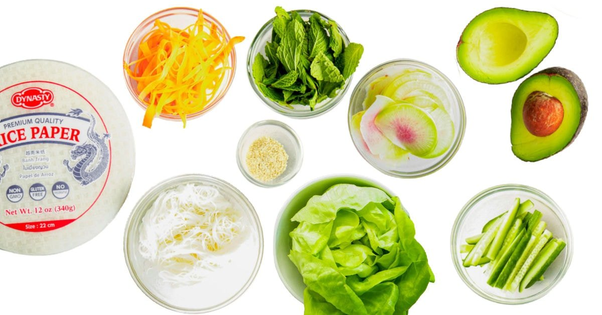 spring rolls ingredients measured out into small bowls and ready to use.