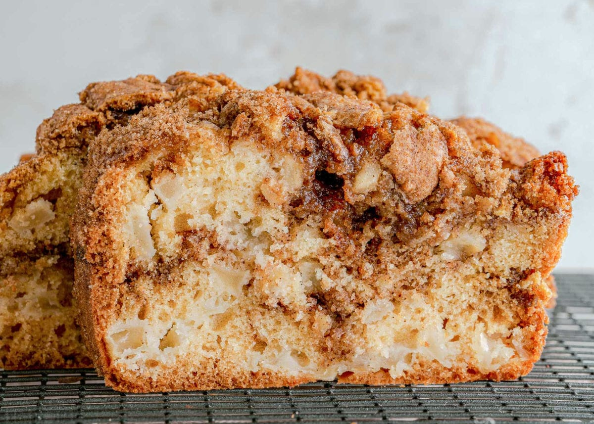 front view of slice of apple bread sitting on a cooling rack.
