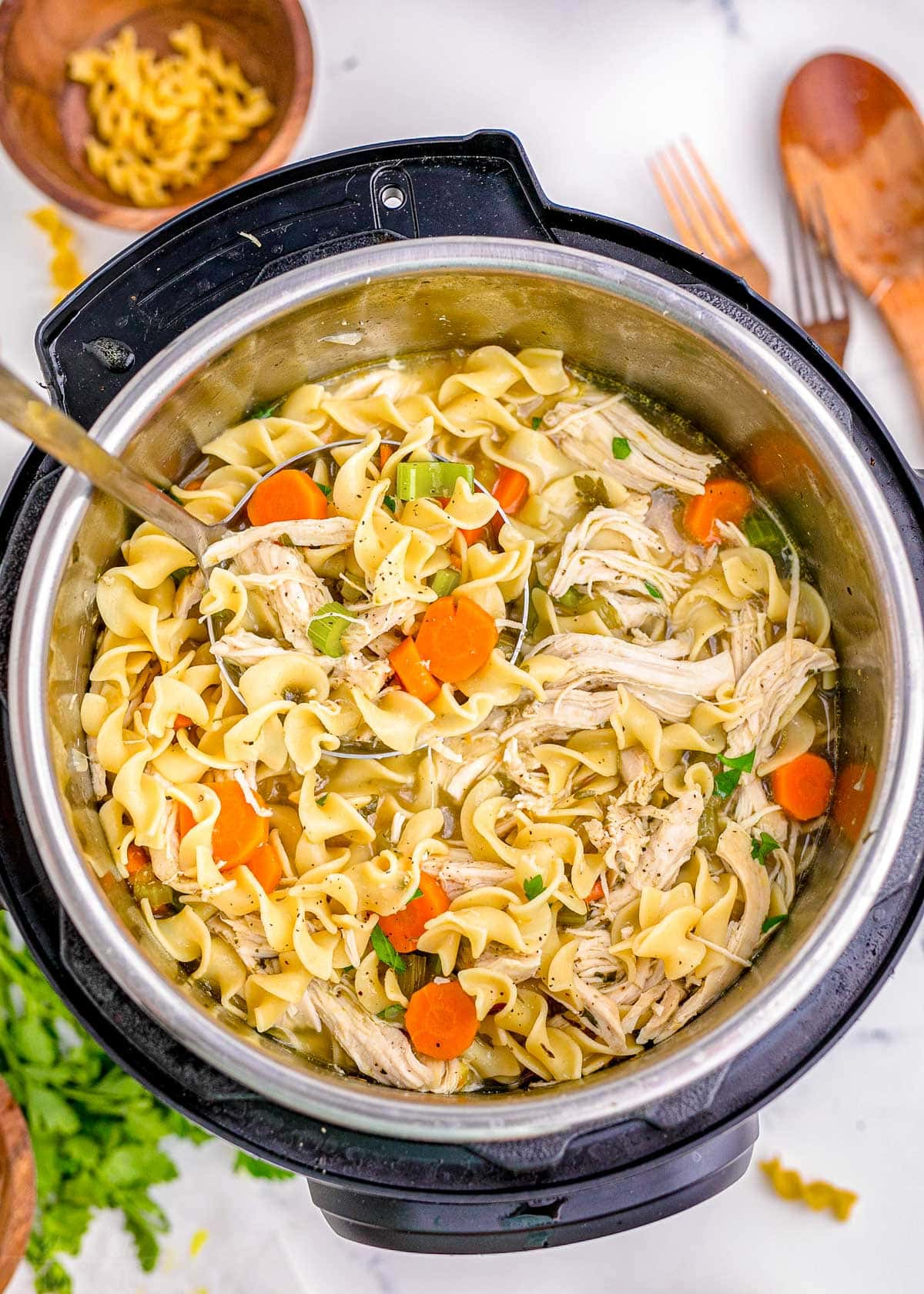 top down look at chicken noodle soup in an instant pot ready to be served.