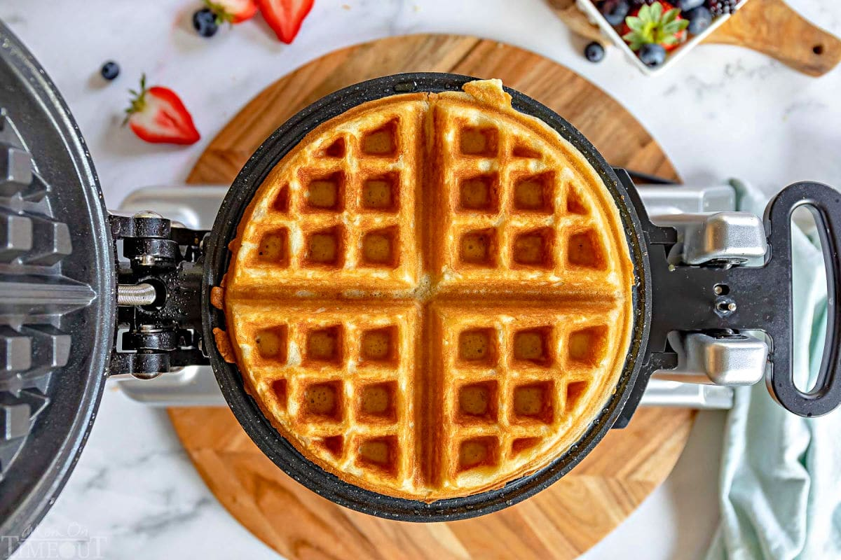 waffle golden and crispy sitting in waffle maker.