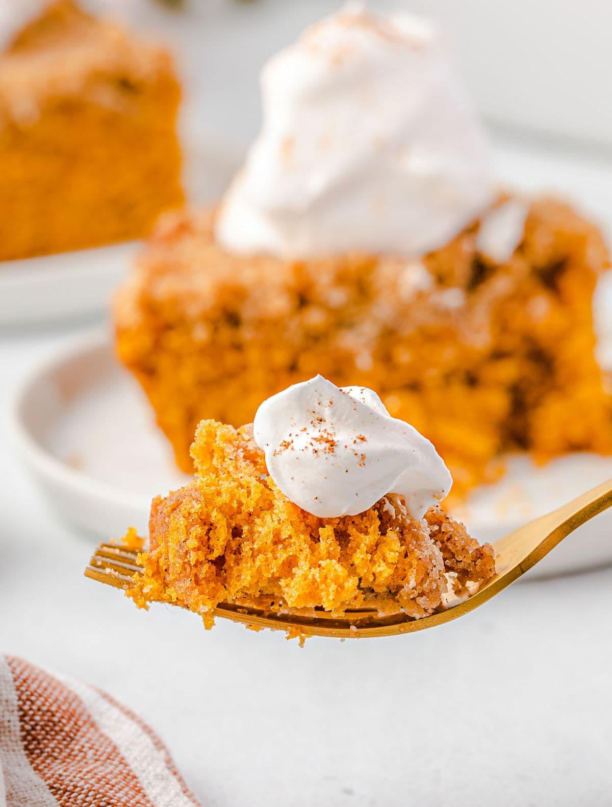 bite of pumpkin coffee cake with whipped cream